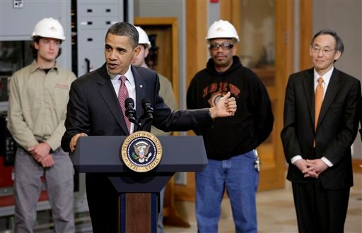 President Barack Obama points to Energy Secretary Steven Chu, right, as he delivers remarks on energy jobs during his visit to International Brotherhood of Electricians (IBEW) Local 26 headquarters in Lanham, Md, Tuesday, Feb. 16, 2010.