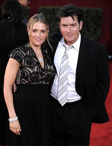 In this Sept. 20, 2009, file photo, actor Charlie Sheen, right, and his wife Brooke Mueller arrive at the 61st Primetime Emmy Awards in Los Angeles. (AP Photo/Chris Pizzello, file)