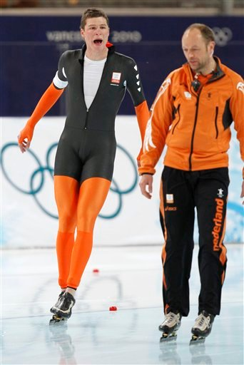 Netherlands's Sven Kramer, left, shouts at his coach Gerard Kemkers, right, after he was disqualified during the men's 10,000 meter speed skating race at the Richmond Olympic Oval at the Vancouver 2010 Olympics.