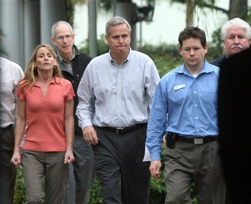 Dan Brown, general manager of SeaWorld Adventure Park, center, walks with Kelly Flaherty Clark, left, curator of animal training at SeaWorld, before holding a news conference, Wednesday, Feb. 24, 2010.
