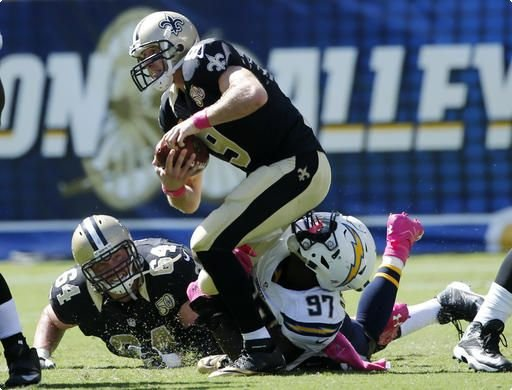 New Orleans Saints quarterback Drew Brees, top, is sacked by San Diego Chargers outside linebacker Jeremiah Attaochu (97) during the second half of an NFL football game Sunday, Oct. 2, 2016, in San Diego.