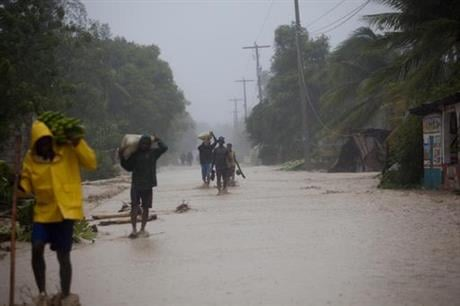 Matthew slammed into Haiti's southwestern tip with howling, 145 mph winds Tuesday, tearing off roofs in the poor and largely rural area, uprooting trees and leaving rivers bloated and choked with debris. ( AP Photo/Dieu Nalio Chery)