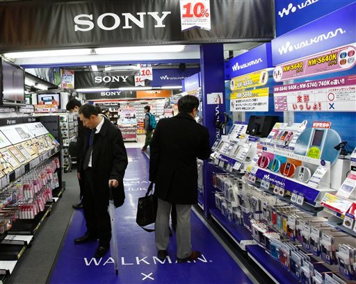 In this Jan. 28, 2010 photo, shoppers check Sony products at a store in Tokyo, Japan. The Japanese manufacturing icon, known for products like the PlayStation 3 game console. (AP Photo/Shizuo Kambayashi).