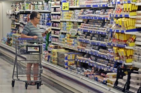 Food prices are falling, but what does that mean for your grocery bill? The government says that food costs are down, but Kroger says people aren't noticing the drop in prices. (AP Photo/LM Otero, File)