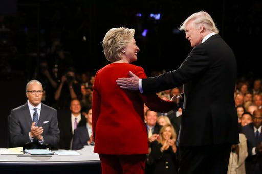 (Joe Raedle/Pool via AP, File). FILE - In this Sept. 26, 2016 file photo, Democratic presidential nominee Hillary Clinton and Republican presidential nominee Donald Trump shake hands during the presidential debate at Hofstra University in Hempstead
