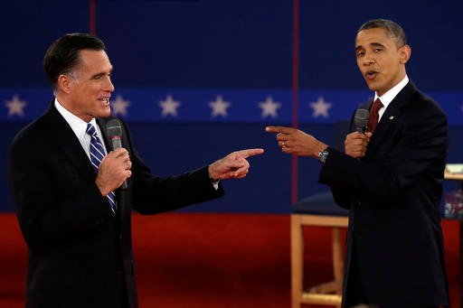 (AP Photo/Charlie Neibergall, File). FILE - In this Oct. 16, 2012 file photo, Republican presidential nominee Mitt Romney, left, and President Barack Obama spar during the second presidential debate at Hofstra University in Hempstead, N.Y. For presiden...
