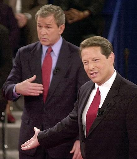 (AP Photo/Ron Edmonds, File). FILE - In this Oct. 17, 2000 file photo, Republican presidential candidate Texas Gov. George W. Bush, left, and Democratic presidential candidate Vice President Al Gore gesture during their third and final debate at Washin...
