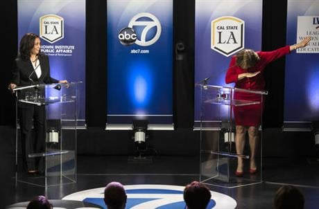 The Orange County congresswoman capped the hour-long event with her fellow Democrat by mimicking a celebratory gesture popularized by NFL star Cam Newton. (Ed Crisostomo/The Orange County Register via AP)