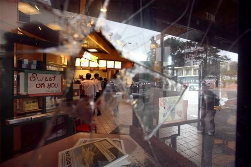 A broken window is seen at a Subway restaurant Friday, Feb. 26, 2010, in Berkeley, Calif.