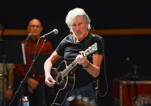 "In this Nov. 4, 2013 file photo, Roger Waters rehearses with members of the Wounded Warriors Project for the ""Stand Up For Heroes"" benefit concert."