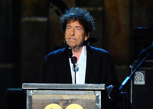 In this Feb. 6, 2015 file photo, Bob Dylan accepts the 2015 MusiCares Person of the Year award at the 2015 MusiCares Person of the Year show in Los Angeles.