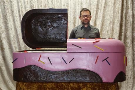 """In this Thursday, Oct. 6, 2016 photo, Pedro Reyes poses for a picture in a section of his installation called """"Doomocracy"""" in New York, Thursday, Oct. 6, 2016. Reyes thinks American politics are pretty darn terrifying, especially this election year."""