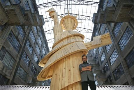 """In this Thursday, Oct. 6, 2016 photo, Pedro Reyes poses for a picture in a section of his installation called """"Doomocracy"""" in New York. Reyes thinks American politics are pretty darn terrifying, especially this election year."""