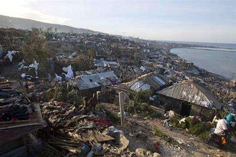 People across southwest Haiti were digging through the wreckage of their homes Friday, salvaging what they could of their meager possessions after Matthew killed hundreds of people in the impoverished country. (AP Photo/Dieu Nalio Chery)