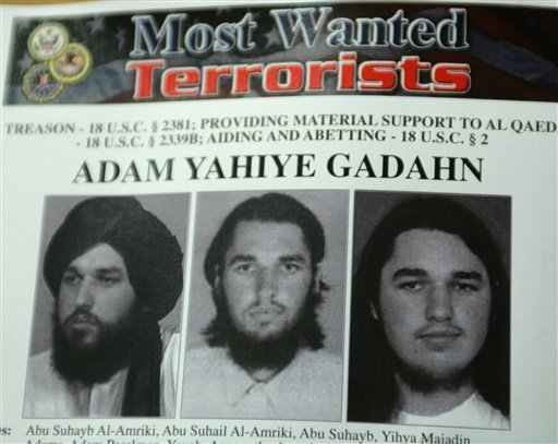 In this Oct. 11, 2006 file photo, a wanted poster of Adam Yahiye Gadahn is displayed at the Justice Department in Washington. Pakistani officials say Adam Gadahn, the American-born spokesman for al-Qaida, has been arrested Sunday March 7, 2010.