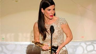 "Sandra Bullock accepts the Oscar for best performance by an actress in a leading role for ""The Blind Side"" at the 82nd Academy Awards Sunday, March 7, 2010, in the Hollywood section of Los Angeles. (AP Photo/Mark J. Terrill)"