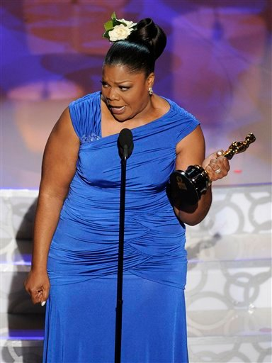 "Mo'Nique accepts the Oscar for best performance by an actress in a supporting role for ""Precious: Based on the Novel 'Push' by Sapphire"" at the 82nd Academy Awards."