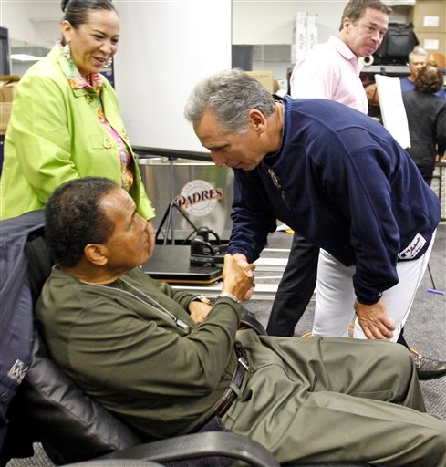 Boxing great Muhammad Ali, left, is greeted by San Diego Padres manager Bud Black at the Padres' spring training baseball facility Monday March 8, 2010 in Peoria, Az. (AP Photo/Lenny Ignelzi)