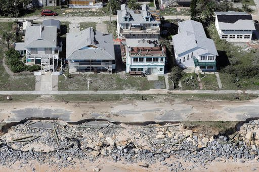 (AP Photo/Chris O'Meara). In this aerial photo, portions of SR A1A are washed out from Hurricane Matthew, Saturday, Oct. 8, 2016, in Flagler Beach, Fla. The damage from Matthew caused beach erosion, washed out some roads and knocked out power for mor...