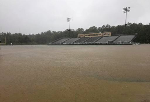 (Sawyer Jordan twitter/sawdiggity via AP). The football field at Conway High School in South Carolina is flooded by rain from Hurricane Matthew, Saturday, Oct. 8, 2016, in Conway, S.C. Hurricane Matthew's estimated losses are a fraction of those racked...