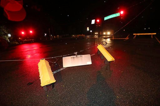 (Curtis Compton/Atlanta Journal-Constitution via AP). Barricades block Highway 40 for downed street lights in the aftermath of Hurricane Matthew at Saint Marys, Ga., on Saturday, Oct. 8, 2016. Matthew plowed north along the Atlantic coast, flooding to...