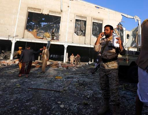 (AP Photo/Osamah Abdulrhman). People inspect the aftermath of a Saudi-led coalition airstrike in Sanaa, Yemen, Saturday, Oct. 8, 2016. Yemeni security and medical officials say at least 45 people have been killed in a Saudi-led coalition airstrike that...