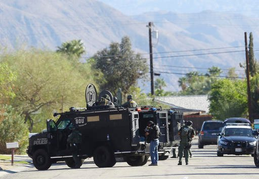 (Omar Ornelas/The Desert Sun via AP). A manhunt is in effect after two Palm Springs, Calif., police officers trying to resolve a family dispute were shot to death Saturday, Oct. 8, 2016, when a man they had been speaking calmly with suddenly pulled out...