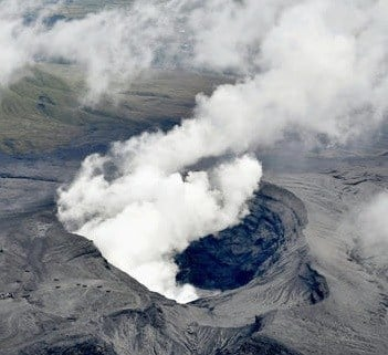 (Hiroko Harima/Kyodo News via AP). In this aerial view, plumes of white smoke rise from Mount Aso Nakadake Crater in Kumamoto Prefecture, southern Japan, Saturday morning, Oct. 8, 2016 following eruptions earlier in the day. Mount Aso has sent huge plu...