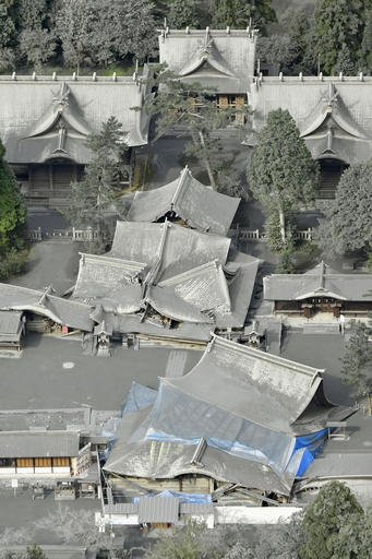 (Hiroko Harima/Kyodo News via AP). This aerial photo shows buildings of Aso Shrine, some flattened and damaged by April's earthquakes, totally covered by gray ash in Aso, Kumamoto Prefecture, southern Japan, Saturday morning, Oct. 8, 2016, following Mo...