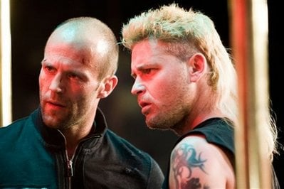 In this 2009 publicity image released by Lions Gate Entertainment, Corey Haim, right, appears with Jason Statham in a scene from 'Crank: 'Crank: High Voltage.'