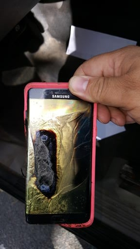 """(Andrew Zuis via AP). This Friday, Oct. 7, 2016, photo provided by Andrew Zuis, of Farmington, Minn., shows the replacement Samsung Galaxy Note 7 phone belonging to his 13-year-old daughter Abby, that melted in her hand earlier in the day. """"She's done ..."""