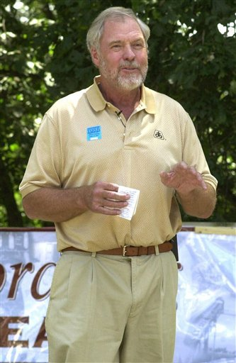 This June 22, 2001, file photo shows Pro Football Hall of Famer and former television actor Merlin Olsen speaking in Urbandale, Iowa.