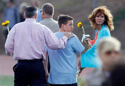 Brent King, left, Kelly King, right, and Tyler King, center, look back towards the crowd as they leave a memorial service held at Poway High School for Chelsea King Saturday March 13, 2010, in Poway, Calif.