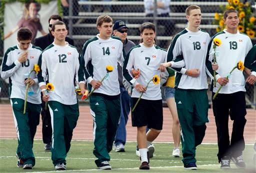 Members of the Poway High School soccer team arrive at a memorial service held at Poway High School for teenager Chelsea King Saturday March 13, 2010, in Poway, Calif.