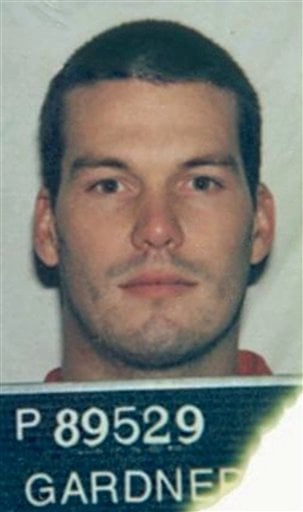 This April 6, 2004 photo released Wednesday, March 10, 2010, by the California Department of Corrections and Rehabilitation shows murder suspect John Albert Gardner III with a prison identification card.