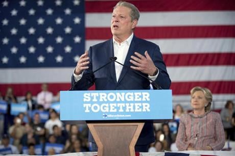 Former Vice President Al Gore, center, accompanied by Democratic presidential candidate Hillary Clinton, right, speaks at a rally at Miami Dade College in Miami, Tuesday, Oct. 11, 2016. (AP Photo/Andrew Harnik)
