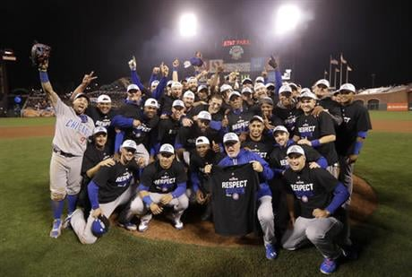 Chicago Cubs players and coaches celebrate after Game 4 of baseball's National League Division Series against the San Francisco Giants in San Francisco, Tuesday, Oct. 11, 2016. The Cubs won 6-5. (AP Photo/Marcio Jose Sanchez)
