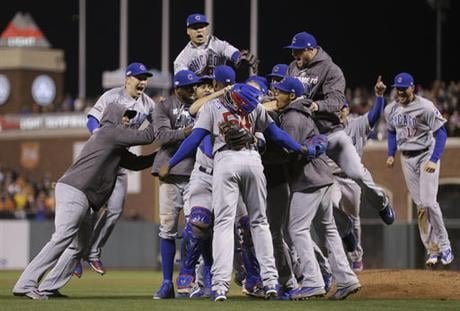 Chicago Cubs players celebrate around pitcher Aroldis Chapman, center foreground, after Game 4 of baseball's National League Division Series against the San Francisco Giants in San Francisco, Tuesday, Oct. 11, 2016. The Cubs won 6-5. (AP Photo/Ben Margot)