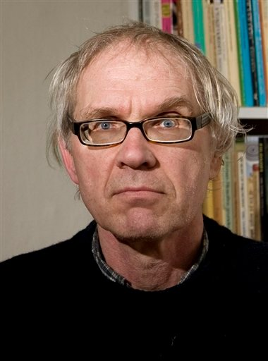 Swedish artist Lars Vilks poses for a photo at his home in Nyhamnslage, southern Sweden on Tuesday March 9, 2010.