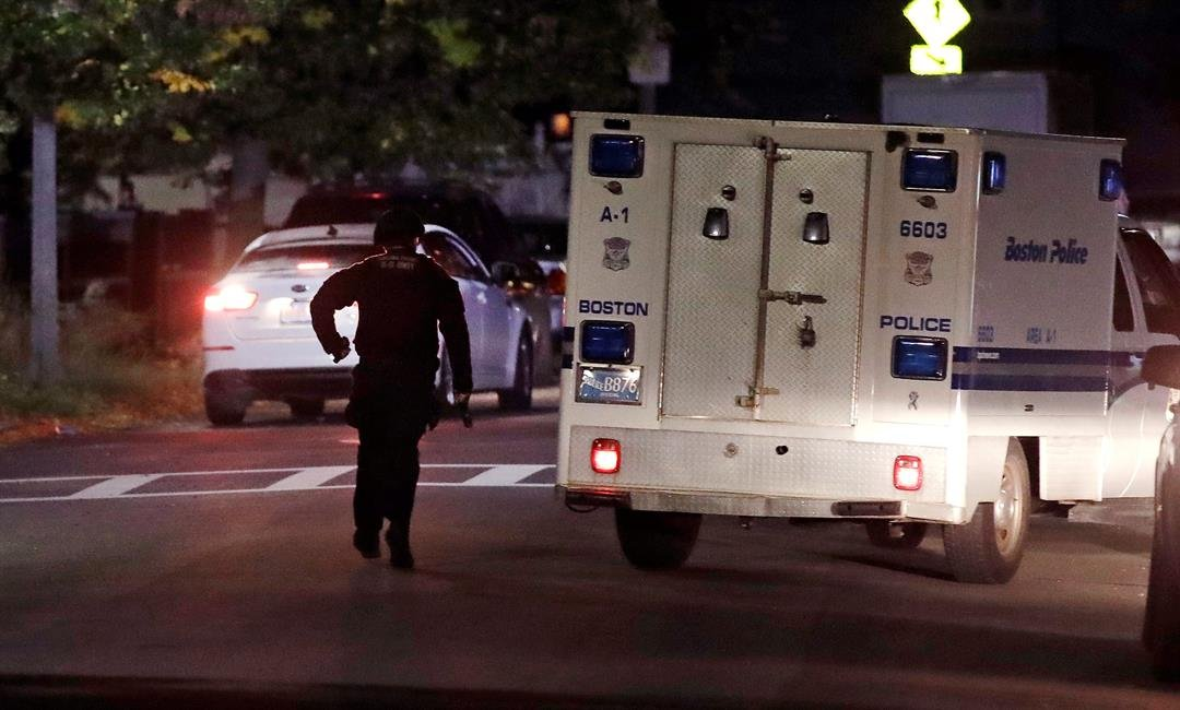 Police say two officers were shot late Wednesday night. Their conditions were not immediately available. It's unclear what led to the shooting. (AP Photo/Charles Krupa)
