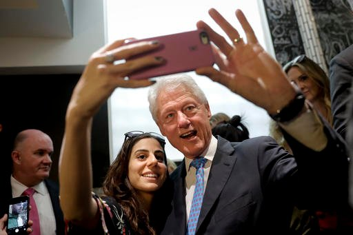 (AP Photo/Jae C. Hong, File). FILE - In this Sept. 13, 2016, file photo, former President Bill Clinton pauses for a selfie with a supporter at a coffee shop while campaigning for his wife, Democratic presidential candidate Hillary Clinton in Los Angele...