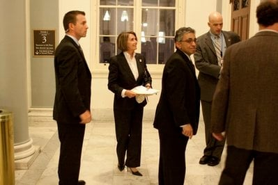 House Speaker Nancy Pelosi, D-Calif., second from left, leaves a Democratic Caucus on Capitol Hill in Washington, Monday, March 15, 2010. (AP Photo/Harry Hamburg)