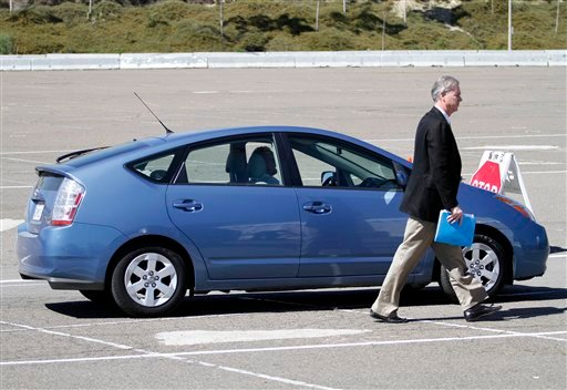 Jeff Bracken, General Manager of the Southern California Region, Toyota Motor Sales, USA, Inc., walks past a Toyota Prius before a news conference held Monday, March 15, 2010 in San Diego.