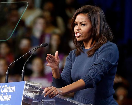 (AP Photo/Jim Cole). First lady Michelle Obama speaks during a campaign rally for Democratic presidential candidate Hillary Clinton Thursday, Oct. 13, 2016, in Manchester, N.H.