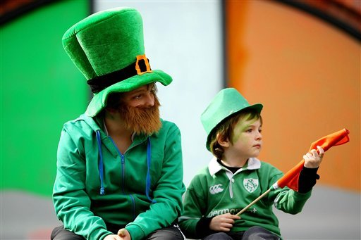 Children watch the St Patrick's Day parade in Dublin, Ireland Wednesday March 17, 2010. Hundreds of thousands of people will mark the national day at more than 180 events in towns and villages across the country. (AP Photo/ Julien Behal/PA)