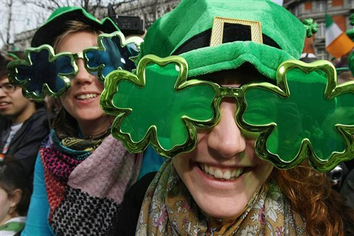 People enjoy the St Patrick's Day parade in Dublin, Ireland Wednesday March 17, 2010. Hundreds of thousands of people will mark the national day at more than 180 events in towns and villages across the country. (AP Photo/Julien Behal/PA)