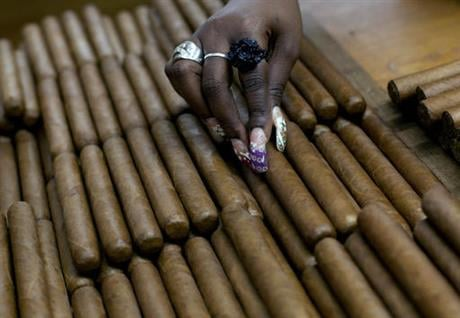 The Obama administration announced Friday, Oct. 14, 2016 it is eliminating a $100 limit on the value of Cuban rum and cigars that American travelers can bring back from the island. (AP Photo/Ramon Espinosa, File)