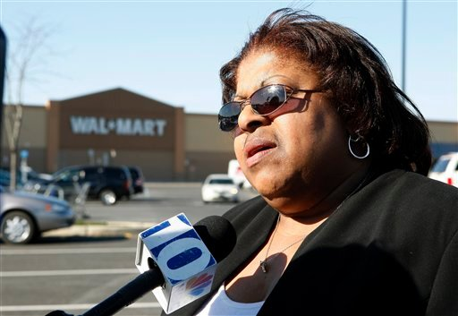 Virginia Tinsley, of Washington Township, N.J., answers a question Wednesday, March 17, 2010, outside a Wal Mart store in Washington Township, N.J., where she and others complained Sunday about comments that came over the store's public address system.