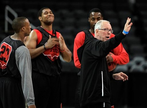 San Diego State head coach Steve Fisher, right, instructs his team during NCAA college basketball practice in Providence, R.I., Wednesday, March 17, 2010.
