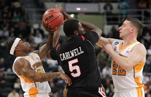 Tennessee's Melvin Goins, left, and Steven Pearl, right, defend against San Diego State's Brian Carlwell during the first half of an NCAA first-round college basketball game in Providence, R.I., Thursday, March 18, 2010. (AP Photo/Elise Amendola)